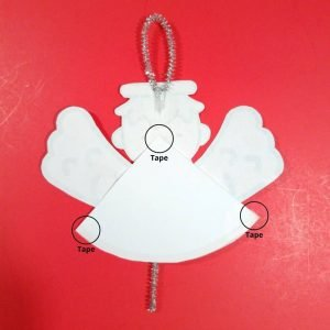 Tape Christmas Angel Ornament together